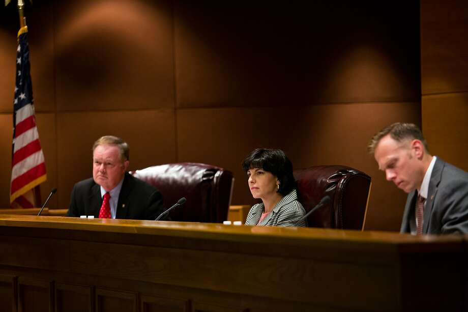 Commissioner Wayne Christian, Chairman Christi Craddick,   and Commissioner Ryan Sitton listen to testimony at the  bi-weekly commissioners' conference, Tuesday, May 23, 2017, in Austin, Texas. Photo: Callie Richmond, Callie Richmond For The Houston Chronicle