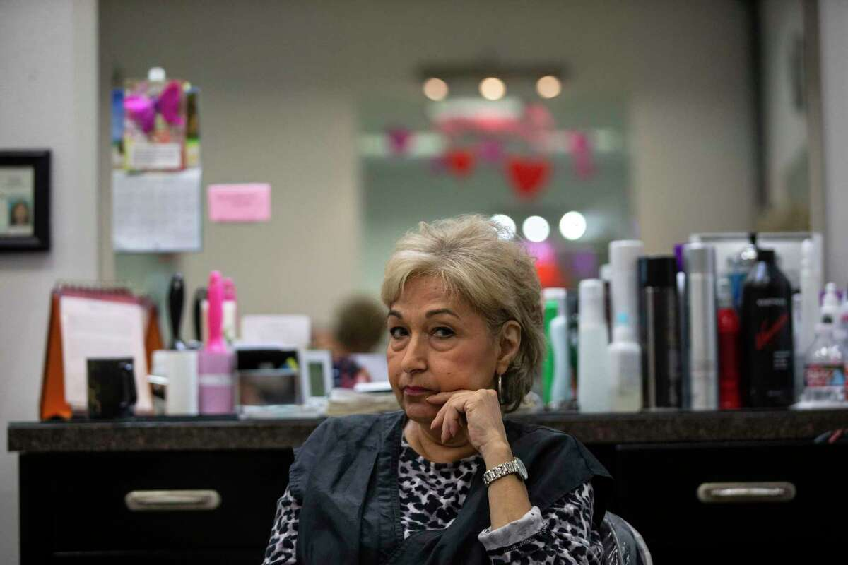 Maria Ritter waits for clients at Sisters Boutique Salon in San Antonio, Texas, on March 19, 2020. Because of the recent coronavirus concerns, Ritter's clients had all canceled for the day.