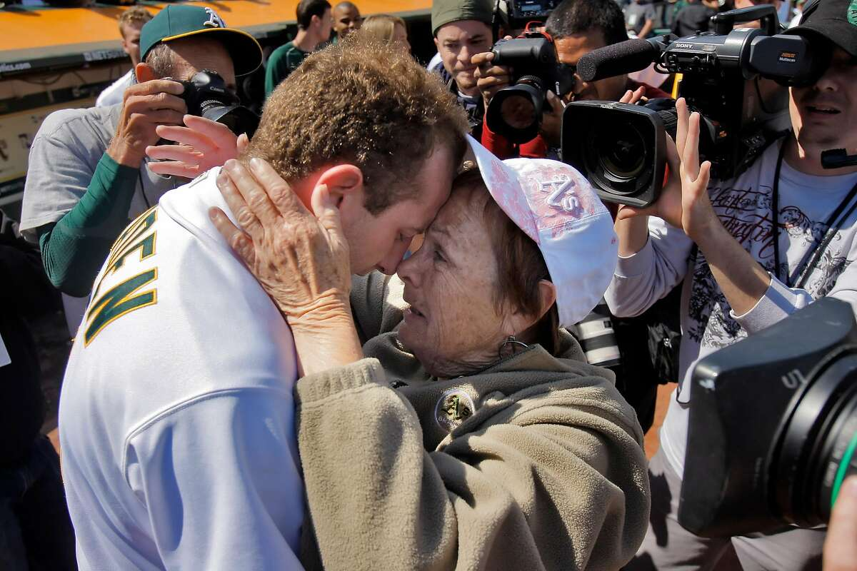 Dallas Braden celebrates with his grandmother, Peggy Lindsey of Stockton, Calif., after pitching a perfect game on Mother's Day. Braden's mother has passed away and his grandmother attended the game. The perfect game is the 19th in MLB history. The Oakland Athletics played the Tampa Bay Rays at the Oakland Alameda County Coliseum in Oakland, Calif., on Sunday, May 9, 2010.