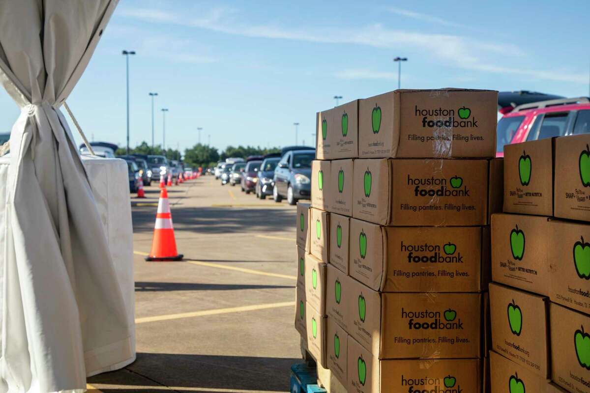 Cars lined up at the Berry Center in Cypress on April 29, 2020, for boxes prepared by the Houston Food Bank.