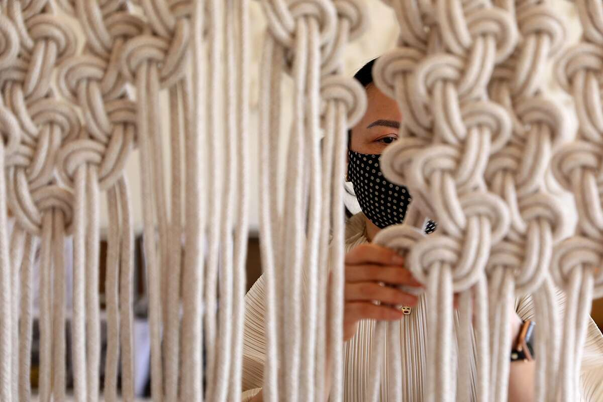 Artist Windy Chien works in her studio on Tuesday, May 5, 2020, in San Francisco, Calif. Chien knots fiber into beautiful wall hangings.