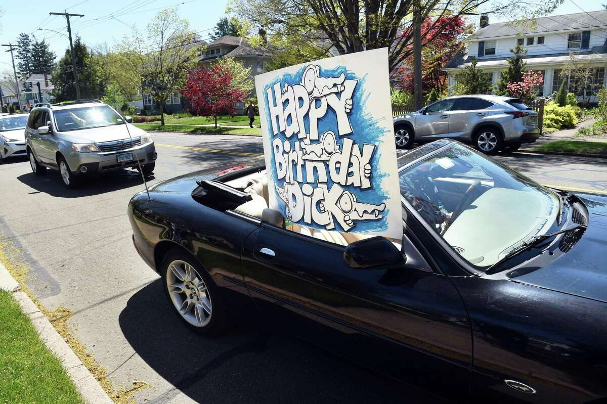 Robert Greenberg of Branford drives by the home of Dick Jacobs in New Haven with birthday wishes for Jacobs' 90th birthday on May 5, 2020.
