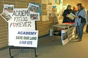 Residents turned out at a special meeting on the fate of the vacant Academy School. The grassroots group, ACADEMY - Save The Heart of Madison, met residents as they entered the public meeting.