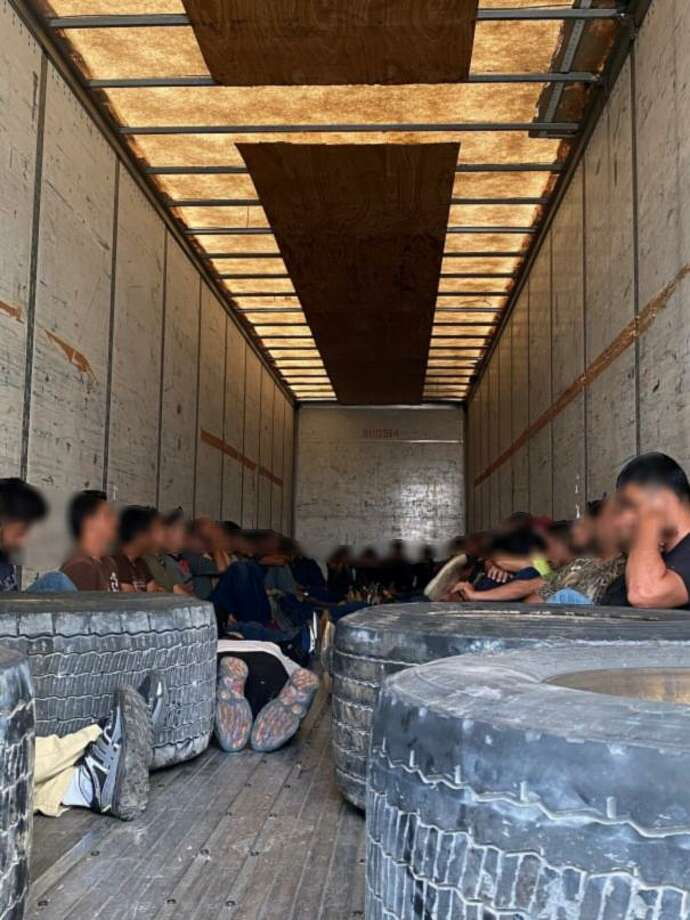 U.S. Border Patrol said they discovered 54 people, including two juveniles, inside a trailer. The human smuggling attempt occurred on Monday at the checkpoint on Interstate 35. Photo: Courtesy Of The U.S. Border Patrol