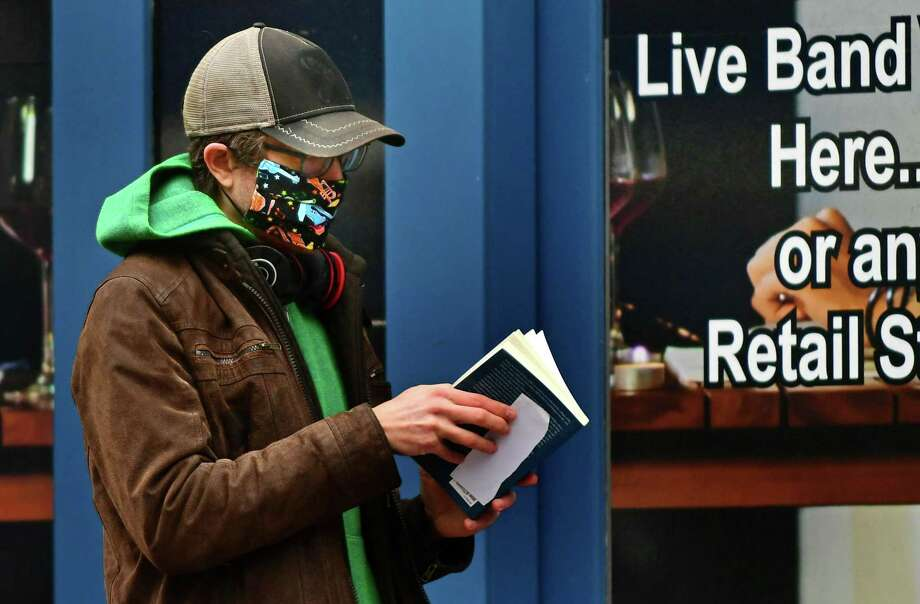 Local residents wear masks against contracting the coronavirus as ordered by the governor Tuesday, April 21, 2020, in Norwalk, Conn. Photo: Erik Trautmann / Hearst Connecticut Media / Norwalk Hour
