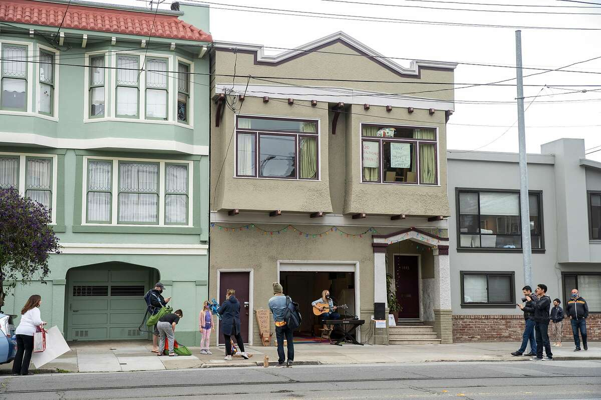 Rachel Garlin performs from her garage to the Noe Valley neighborhood on Friday, April 17, 2020, in San Francisco, Calif.