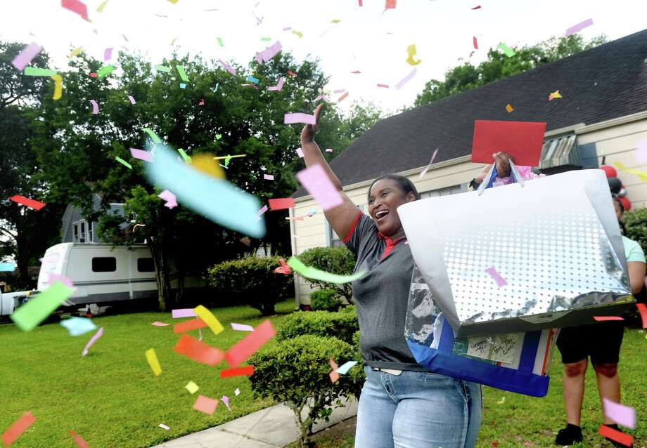 Zelma Nico, district-wide secondary teacher of the year waves to a parade of passing cars amid a shower of confetti after being suprised with the award at her home in Port Arthur as part of Port Arthur ISD's teacher of the year awards and celebration Tuesday. Two of the district-wide honorees - Nico of Thomas Jefferson Middle School, and Adams Elementary's Skylar Slaughter - were surprised at their homes, and in the afteroon an award ceremony with drive-thru parade for all winners at each campus took place at the administration building. Photo taken Tuesday, May 5, 2020 Kim Brent/The Enterprise Photo: Kim Brent / The Enterprise / BEN