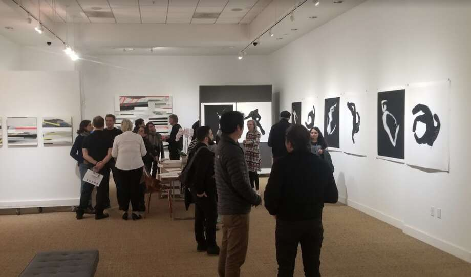 FILE - Guests mingle inside Art Ventures Gallery in March. The gallery reopened Saturday and plans to open again Wednesday in spite of the modified shelter-in-place order, which does not define art galleries as essential businesses. Photo: Google Maps