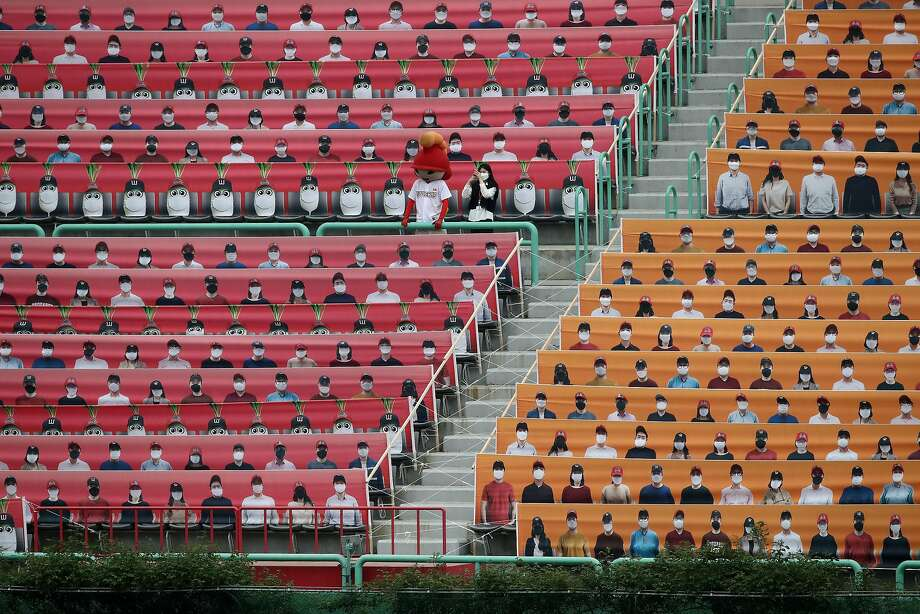Stands are filled with placards of fans during the Korean Baseball Organization League opening game between the host SK Wyverns and Hanwha Eagles at the empty SK Happy Dream Ballpark on May 05. Photo: Chung Sung-Jun / Getty Images