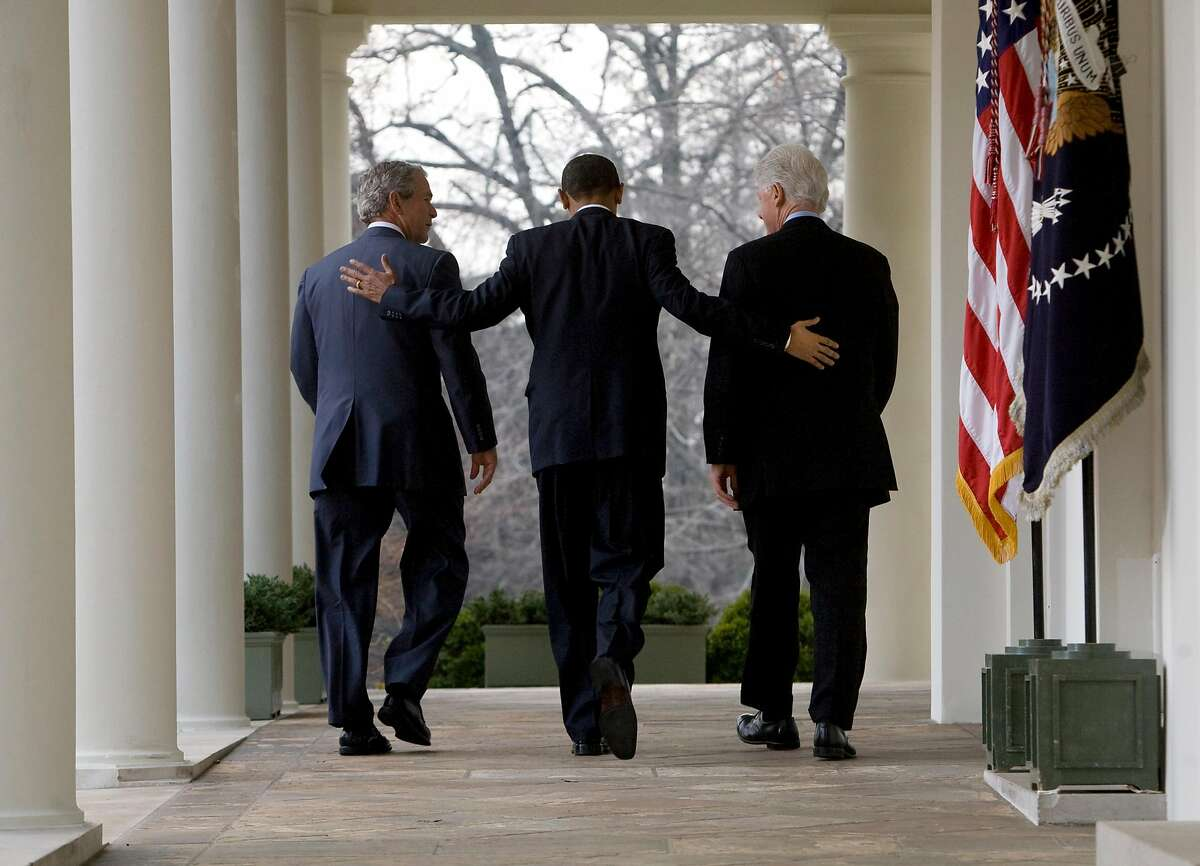 FILE -- President Barack Obama, with former Presidents George W. Bush, left, and Bill Clinton at the White House on Saturday, Jan. 16, 2010, announced that the two would lead a drive to raise money for Haiti's survivors. Aides and allies increasingly believe the President Donald Trump's daily coronavirus task force briefings are hurting him more than helping, and are urging him to let his medical experts take center stage. (Stephen Crowley/The New York Times)