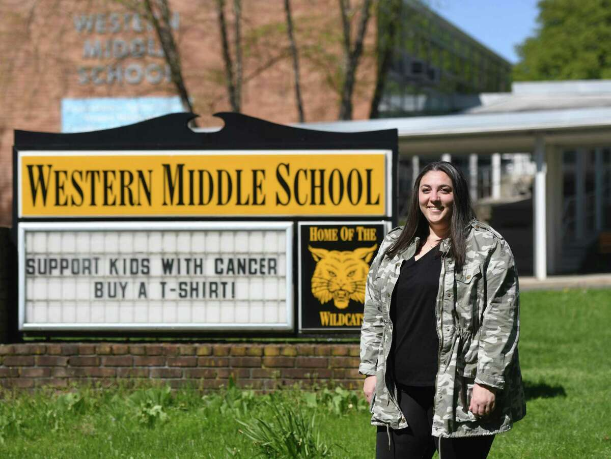 School counselor Erin Montague poses outside Western Middle School in Greenwich, Conn. Tuesday, May 5, 2020.