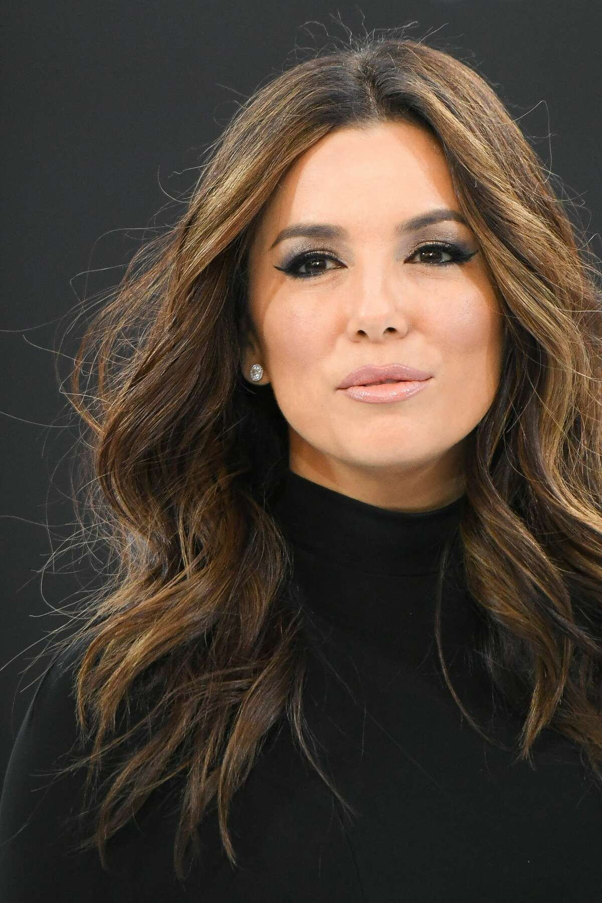 Although it may not look like it, Eva has been seen sporting gray hairs, which she is quick to promote the Loreal products she is a spokesperson for to cover them up.