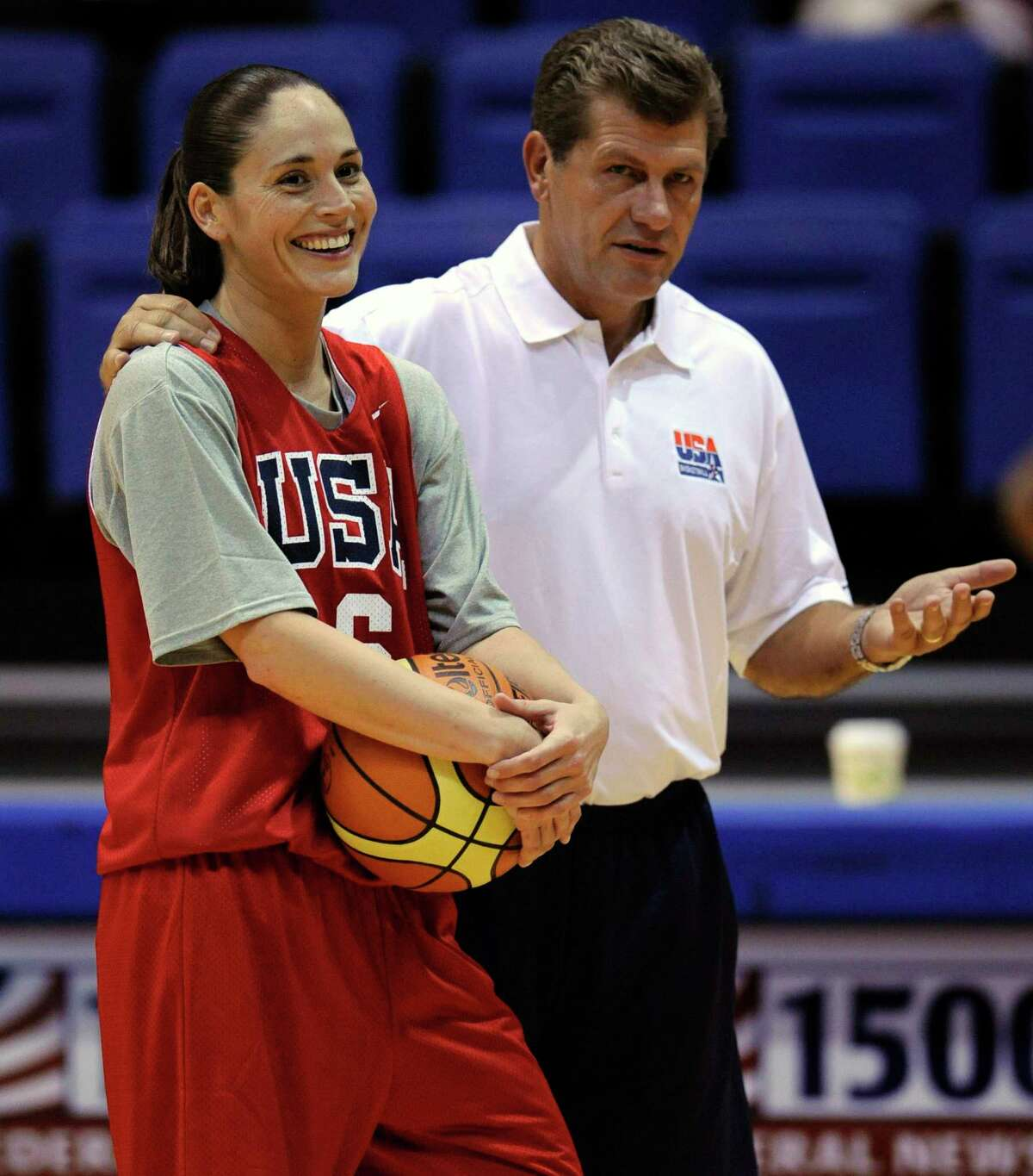 Geno Auriemma, head coach of the 2009 USA women's basketball national team, stands with Sue Bird during their fall training camp at American University in Washington, D.C., in September 2009.