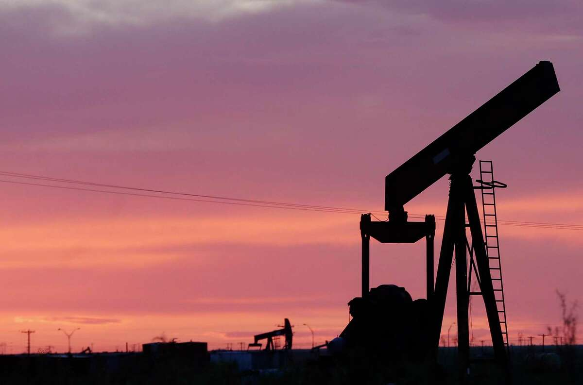 An oil pump jack without its horsehead sits in a field as the sunsets in Penwell. Banks could be tested again by the second oil bust in five years.Callon Petroleum has suspended well completions and is idling more rigs in response to the coronavirus-driven oil crash.