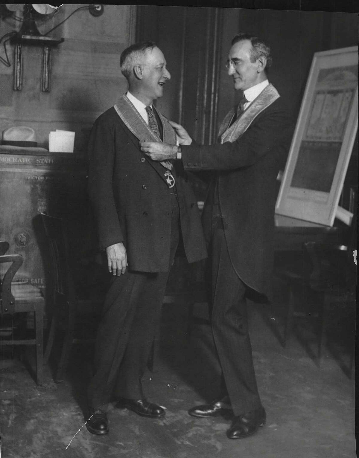 New York City--On the 139th birthday of the Tammany Society of New York, Governor Alfred E. Smith was formally installed as Sachem of the Society, by surrogate James A. Foley, who presided over the ceremonies tonight. Photo shows left to right Governor Alfred E. Smith and Judge Foley. May 14, 1928 (Times Union Archive)
