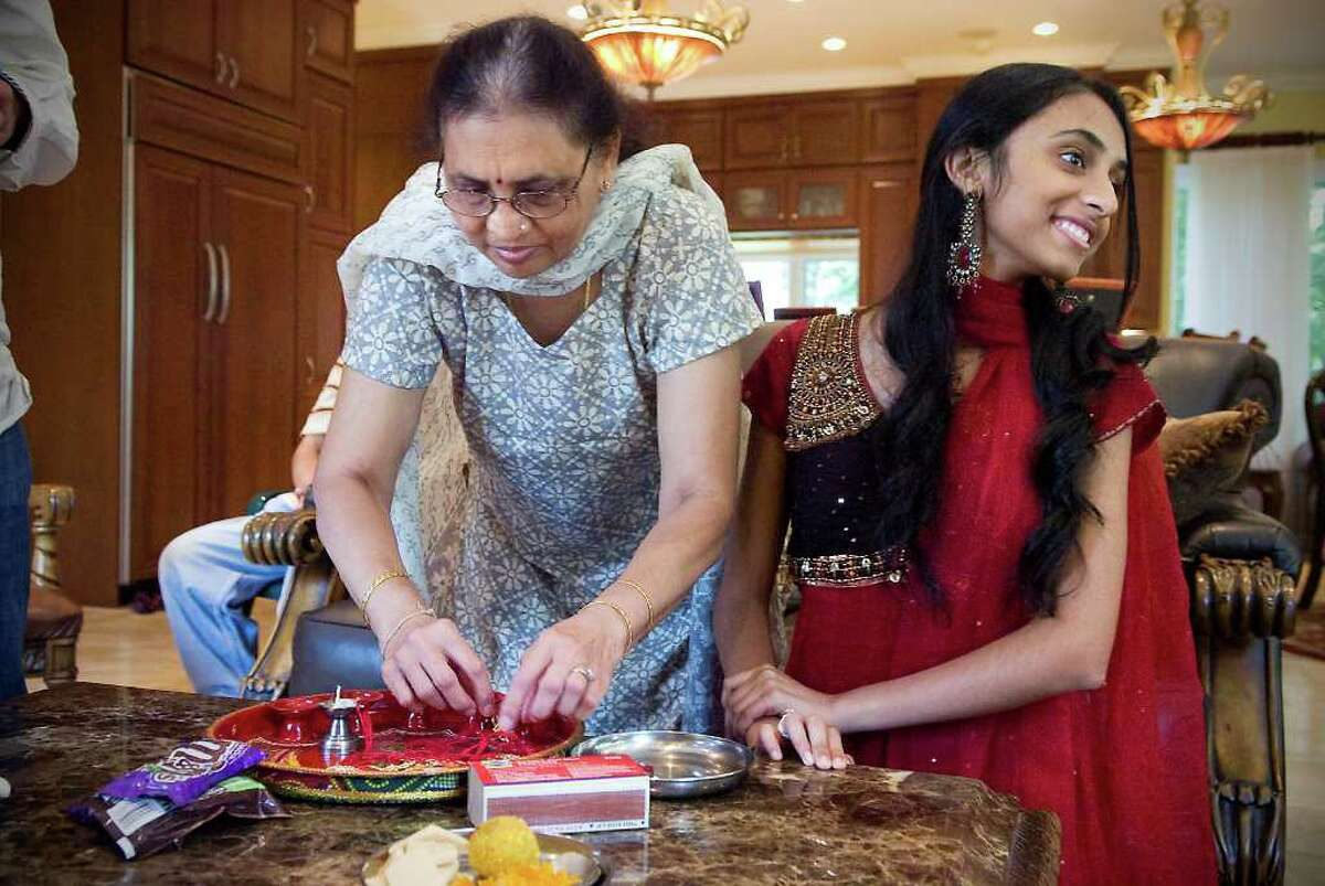 Sunanda Patel and her granddaughter Sheena Patel, 15, prepare to celebrate Raksha Bandhan, a Hindu festival, which honors the relationship between brothers and sisters in Stamford, Conn. on Saturday August 21, 2010. Sheena tied a rakhi, or holy thread, on the wrist of her cousin Kush Patel which symbolizes a promise to protect her throughout her life.