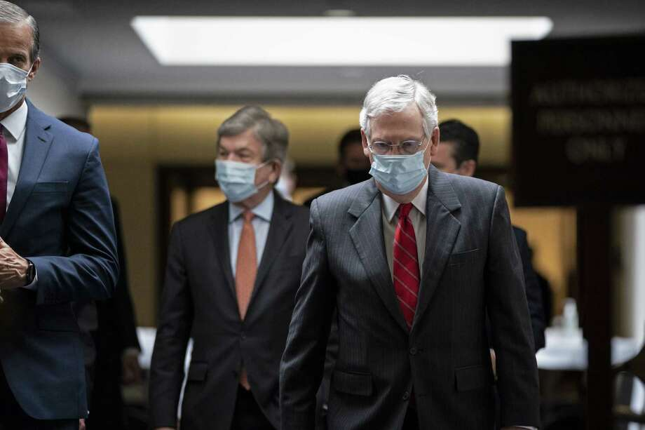 (Left to right) Sen. John Thune (R-SD), Sen. Roy Blunt (R-MO), and Senate Majority Leader Mitch McConnell (R-KY) leave a Senate Republican policy luncheon in the Hart Senate Office Building, May 5, 2020 in Washington, DC. McConnell said that his Senate GOP caucus wants to take a pause on another coronavirus relief bill for now and evaluate legislation that has already passed. Photo: Drew Angerer / 2020 Getty Images