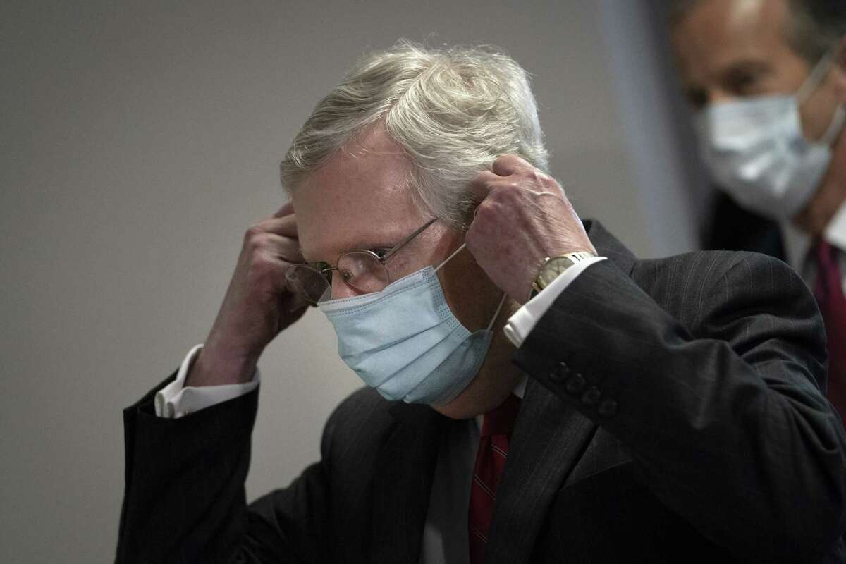 Senate Majority Leader Mitch McConnell (R-KY) puts on a face mask as he leaves a Senate Republican policy luncheon in the Hart Senate Office Building, May 5, 2020 in Washington, DC. McConnell said that his Senate GOP caucus wants to take a pause on another coronavirus relief bill for now and evaluate legislation that has already passed. (Photo by Drew Angerer/Getty Images)