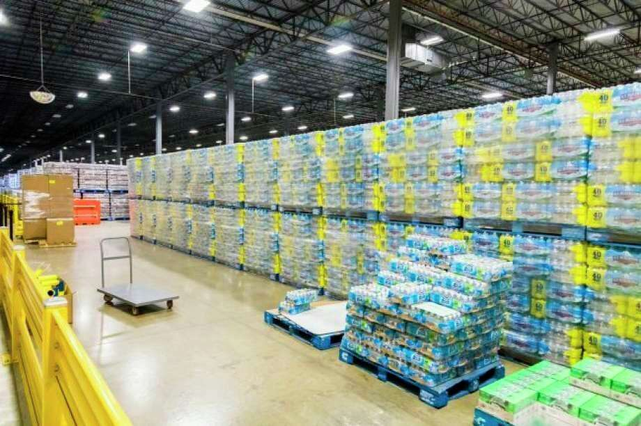 Stacks of bottled water await shipment at the Ice Mountain bottling facility in Stanwood.Nestle received approval to increase its water withdrawal capacity at its White Pine Springs well in Osceola Township, from 250 gallons per minute to 400 gallons per minute. (Herald Review file photo)