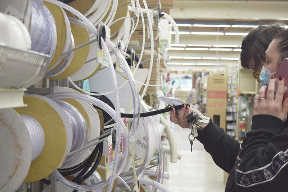 Donna Stambaugh (right) and Alex Stambaugh, both of Franklin, look at hoses at Ace Hardware. Photo: Samantha McDaniel-Ogletree | Journal-Courier
