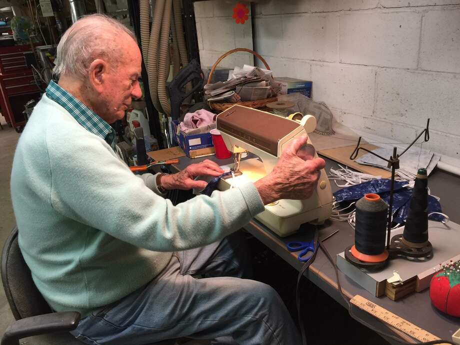 Frank Gallo of New Canaan, a 94-year-old World War II veteran, is sewing masks for health care workers fighting the COVID-19 outbreak. Photo: Contributed Photo / New Canaan Advertiser Contributed