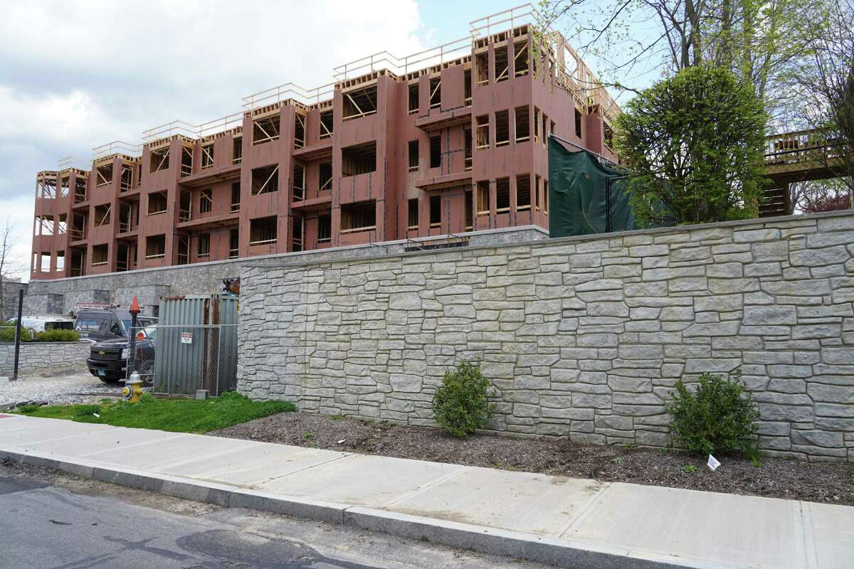 This building of The Vue, once called Merritt Village, faces Park Street near Mead Memorial Park in New Canaan. The faux rock wall around the building became a major controversy when it was first built.