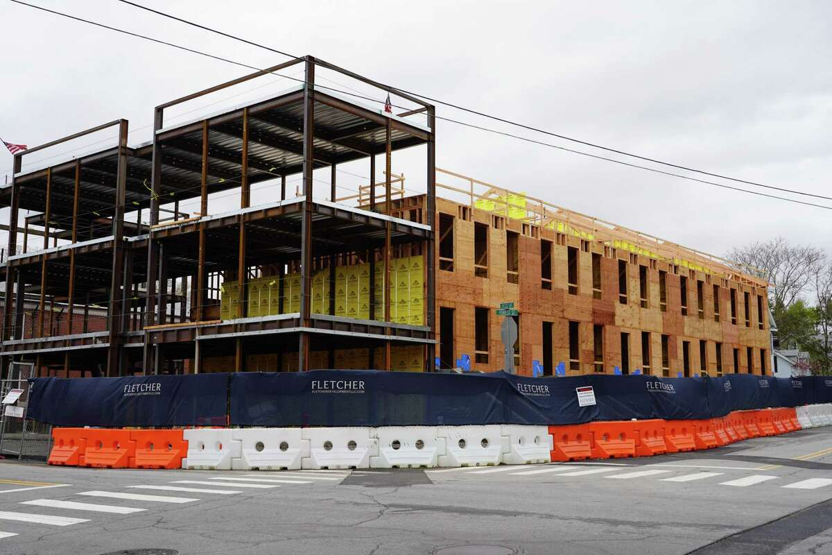 A bank at 42 Forest Street in New Canaan was recently demolished to make room for the Silver Heights mixed-use development. The building is expected to have 1,300 square feet of ground-floor retail space facing Locust Avenue, topped by two condo units, and five townhouse-style condo units with entrances on Forest.