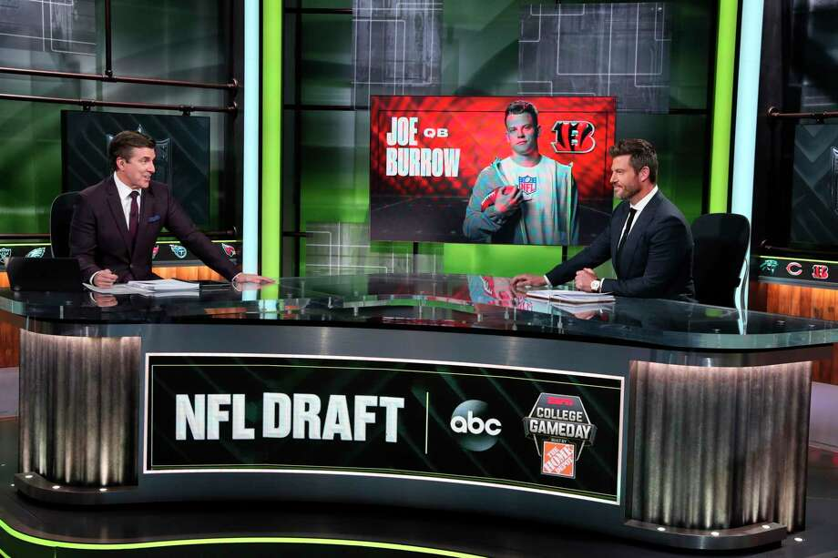 In a photo provided by ESPN Images, Rece Davis, left, and Jesse Palmer discuss the NFL football draft, Thursday, April 23, 2020, in Bristol, Conn. (Allen Kee/ESPN Images via AP) Photo: Allen Kee / Associated Press / Copyright 2020 ESPN