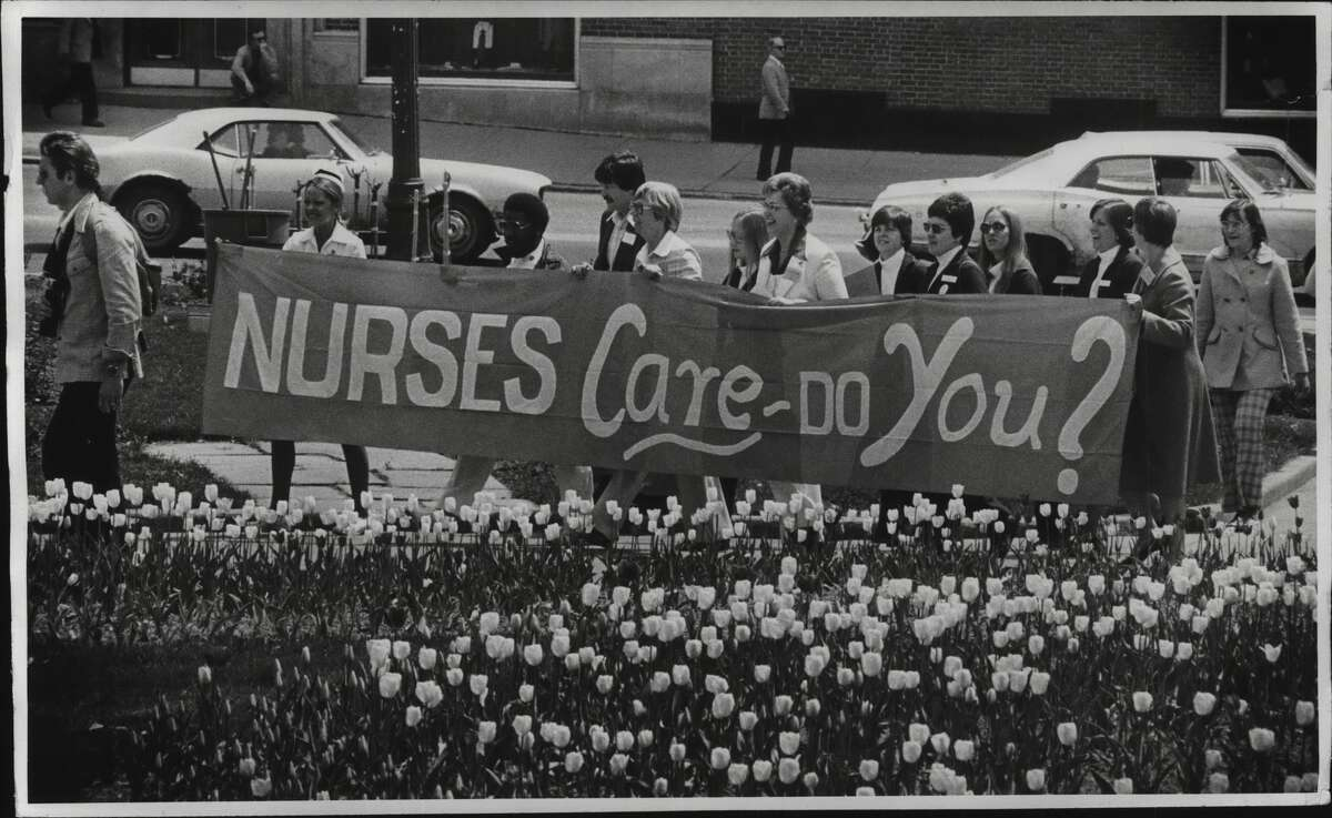 New York State Nurses Association, State Capitol new tulip bed, Albany, New York, enroute to Capitol steps from march up State Street - pix looking east. May 9, 1977