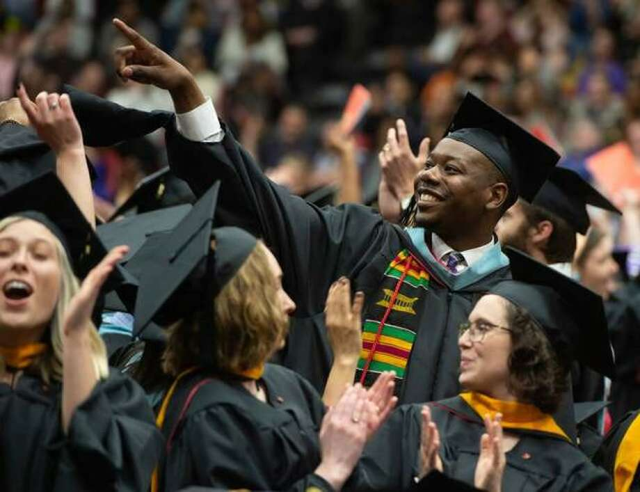 Students rise to thank their parents and family at the evening graduate commencement last May at SIUE. Photo: Courtesy Of Howard Ash Via SIUE