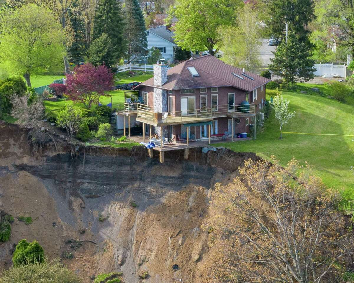 Aerial view of the Middletown Road landslide on Tuesday, May, 5, 2020, in Waterford, N.Y. This home is on the edge of a large, sloping hill gave way on Sunday dropping about 150 feet into a pond below. (Jim Franco/Special to the Times Union)