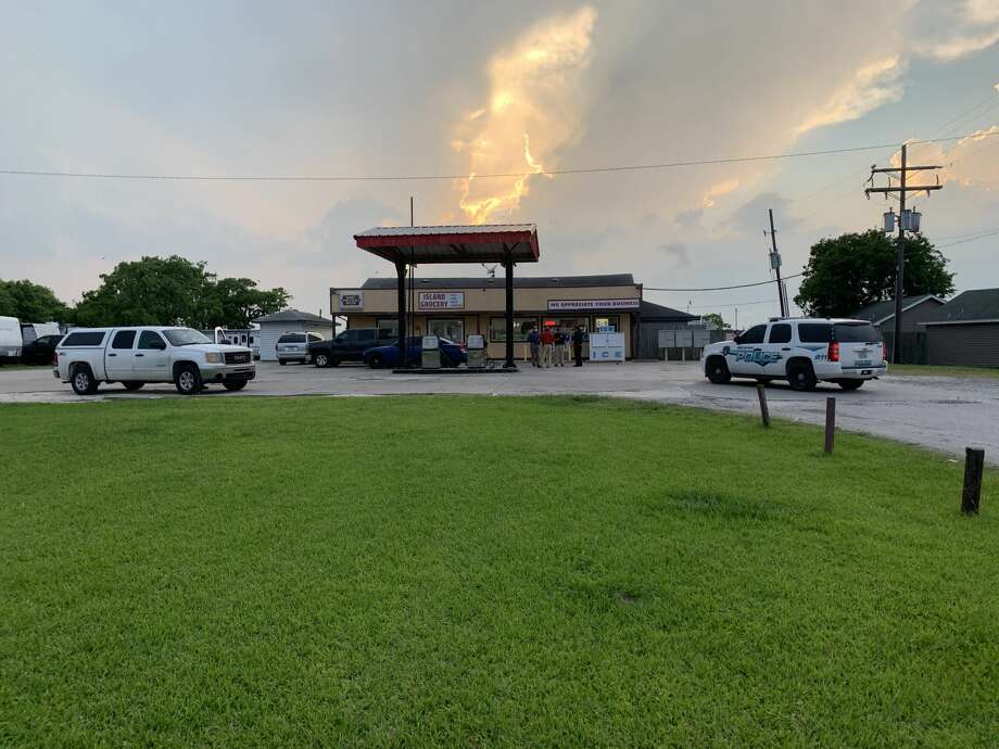 Port Arthur police respond to two incidents on TX 82 Tuesday - first an armed robbery at Island Grocery, then later reports of a shooting just a few miles down the road. When officers arrived, they found a man dead in the roadway. Photo provided by Eric Williams Photo: Eric Williams