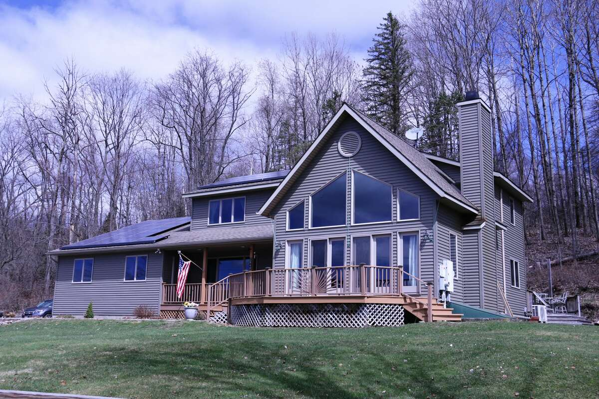 A home on Glass Lake was built in 2000. Includes four bedrooms and three and a half bathrooms. Listing here