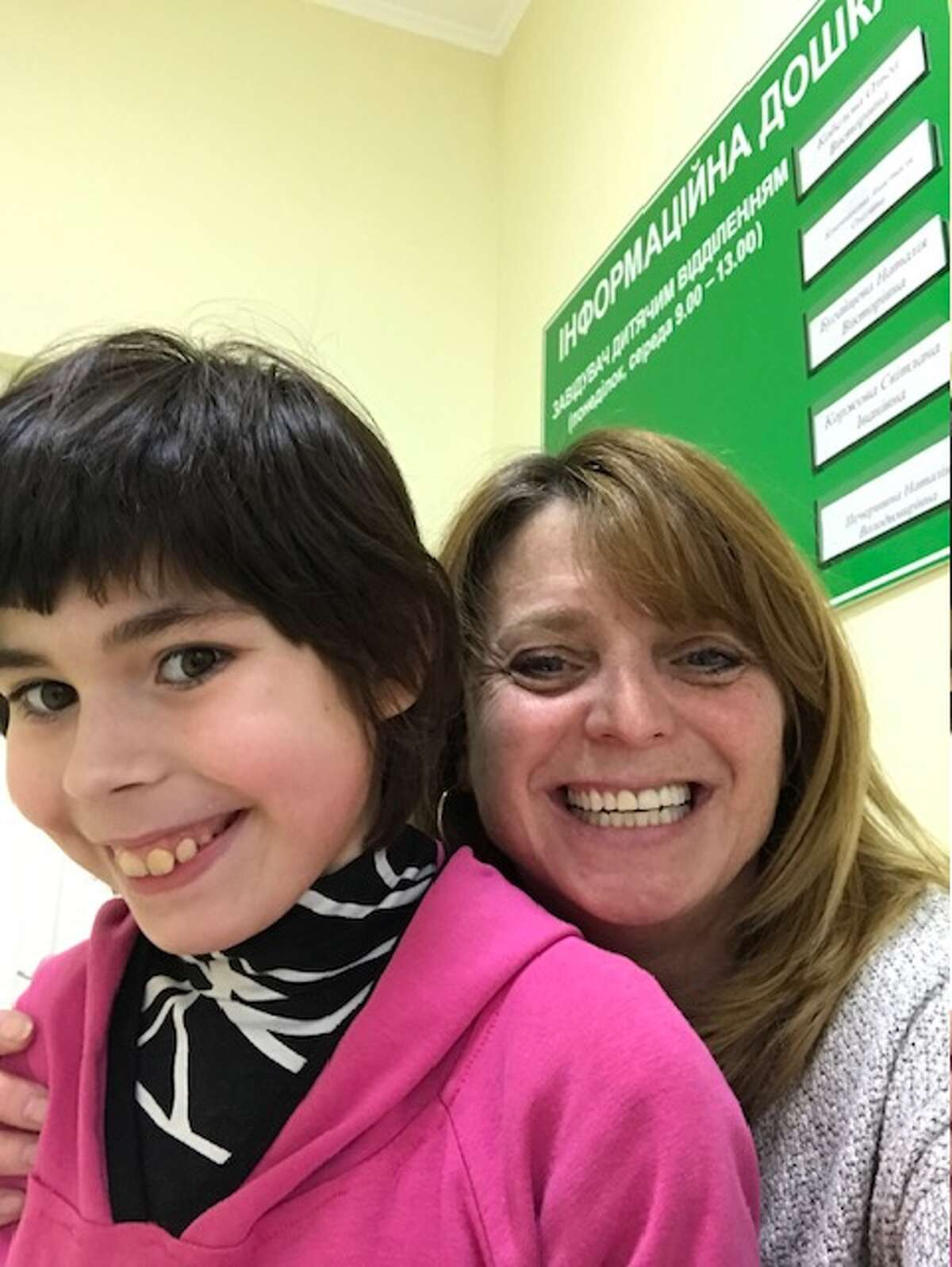 """Myroslava """"Mira"""" Chumakova, left, now 10, with Theresa Grimes of Albany, her soon-to-be adoptive mother pictured in Ukraine during a visit in February 2020. Grimes went to pick Mira up in mid-March 2020, but returned to the U.S. without her due to travel restrictions caused by COVID-19. (Provided photo)"""
