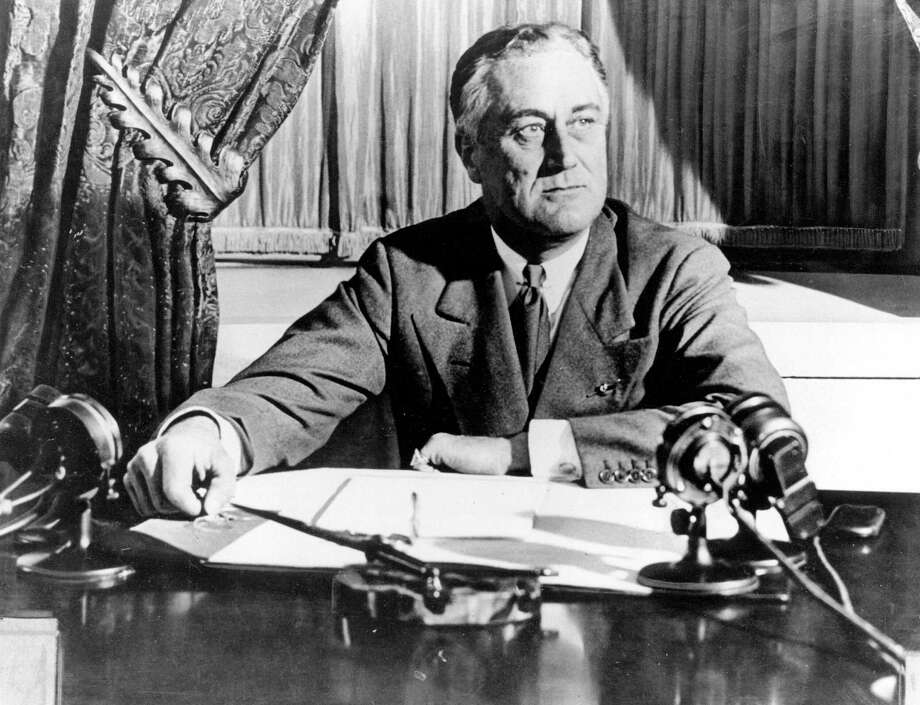 """President Franklin D. Roosevelt delivers his first radio """"fireside chat"""" in Washington in March 1933. Photo: Associated Press / 1933 AP"""