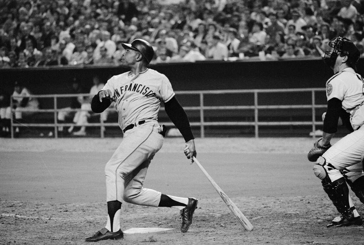 (Original Caption) San Francisco Giants slugger Willie Mays watches the ball he just hit go over the left field fence at the Astrodome in Houston. The homer was May's 511th in his National League career and ties the record held by the late Mel Ott. Mays hit the homer in the 8th inning of a game with the Houston Astros. Astros Jim Owens was pitching.