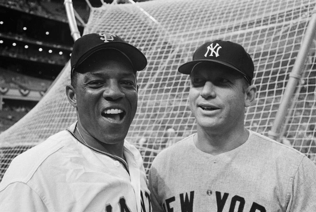 Willie Mays and Mickey Mantle stand together at the 1968 All-Star Game in Houston. Mays was captain of the National League, Mantle the American League.