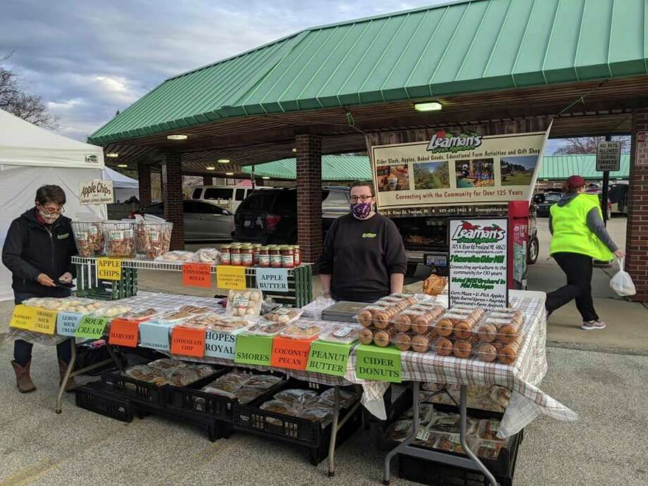 Aphoto on the Midland Area Farmers Market (Michigan) Facebook page shows Leaman's Applebarn booth at the market on Saturday, May 2, 2020. (Facebook photo)