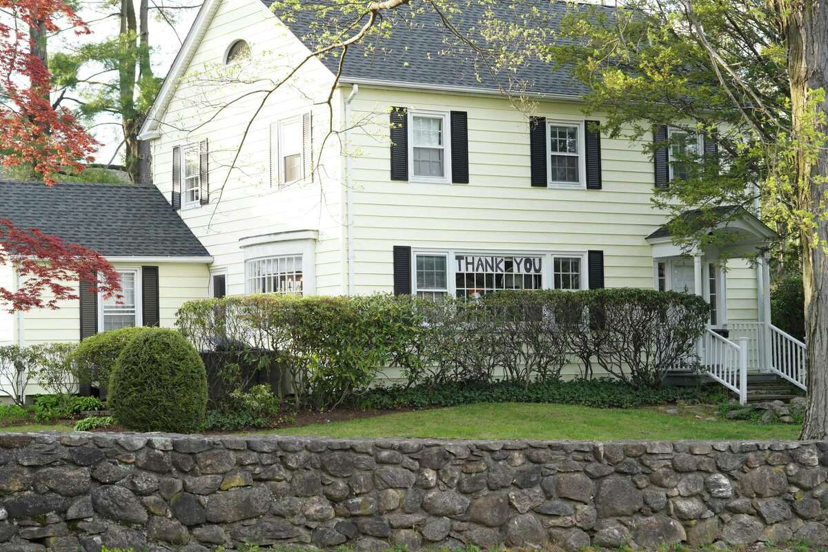 New Canaan is showing its gratefulness, and giving thanks to the first responders, and essential workers who are working during the coronavirus pandemic with signs at different locations throughout the town such as one here at a house.