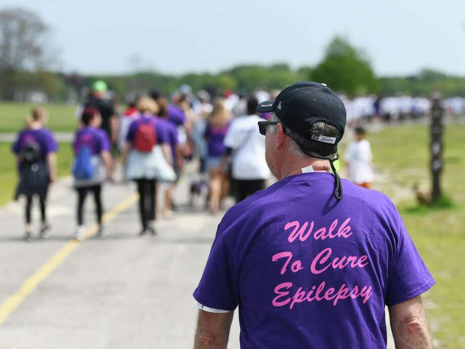 Monroe resident Mike Bonomo walks in the Walk to End Epilepsy at Cove Island Park in Stamford, Conn. Sunday, May 19, 2019. About 200 walkers and 50 cyclists participated to support epilepsy awareness and raise money for the Epilepsy Foundation of Connecticut. The Stamford walk was the last in the series of walks in Connecticut and the group is very close to reaching its target goal of raising $100,000. Photo: File / Tyler Sizemore / Hearst Connecticut Media / Greenwich Time