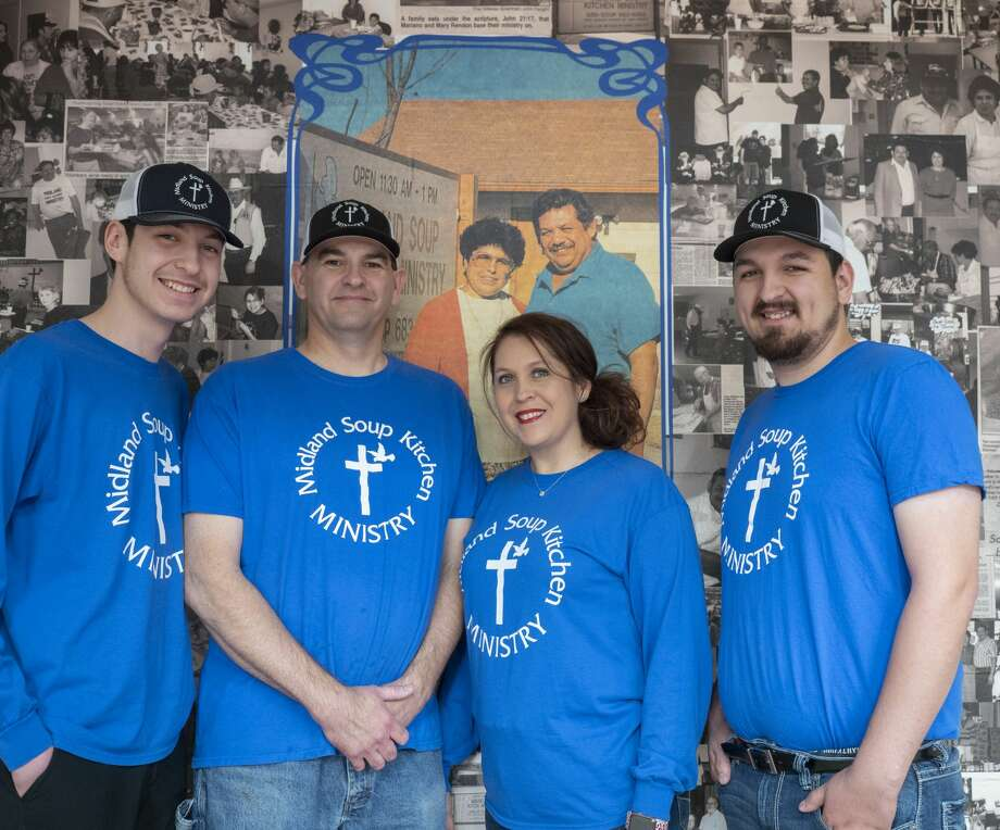 Jason and Nancy Ivy, center, with their sons Nathen, left, and Jay Anthony, stand in front of a memory wall that bears a picture of Nancy's parents, Mary and Mariano Rendon. The Rendons started the Midland Soup Kitchen Ministry in 1984; Nancy and her family operate it now. Photo: Tim Fischer/Midland Reporter-Telegram