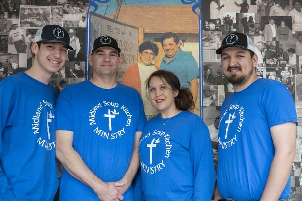 Jason and Nancy Ivy, center, with their sons Nathen, left, and Jay Anthony, stand in front of a memory wall that bears a picture of Nancy's parents, Mary and Mariano Rendon. The Rendons started the Midland Soup Kitchen Ministry in 1984; Nancy and her family operate it now.
