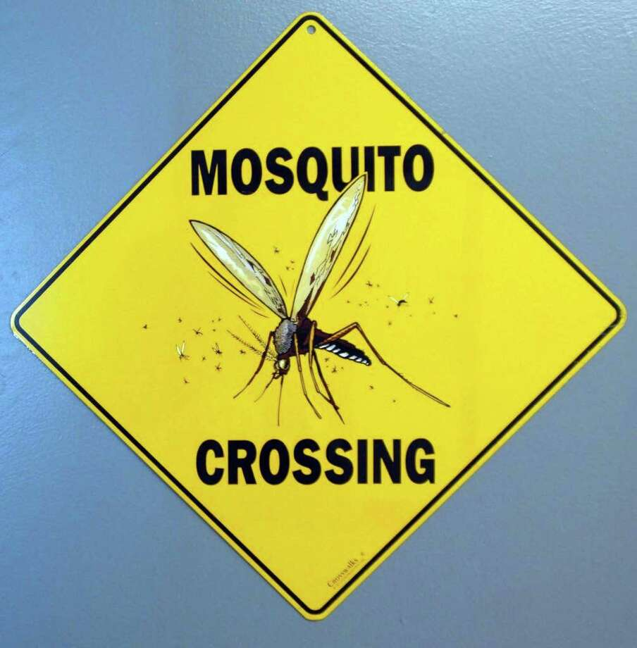Sign on the Mosquito Rearing Room at the Connecticut Agricultural Experiment Station in New Haven. Photo: Peter Hvizdak / Hearst Connecticut Media / New Haven Register