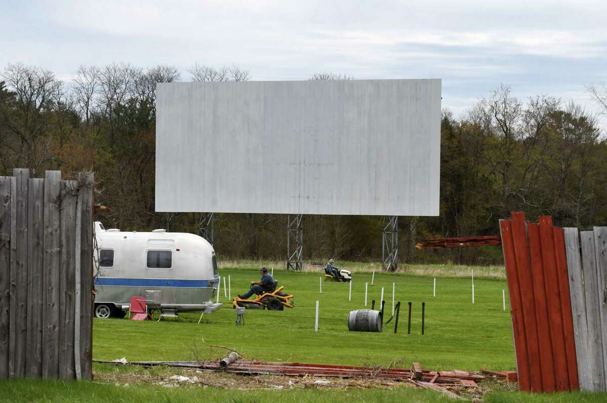 Grass is mowed at the Greenville Drive-In on Wednesday, May, 6, 2020, in Greenville, N.Y. Some schools are working with drive-in movie theaters to come up with a way to celebrate their graduating seniors during the coronavirus lockdown. (Will Waldron/Times Union)