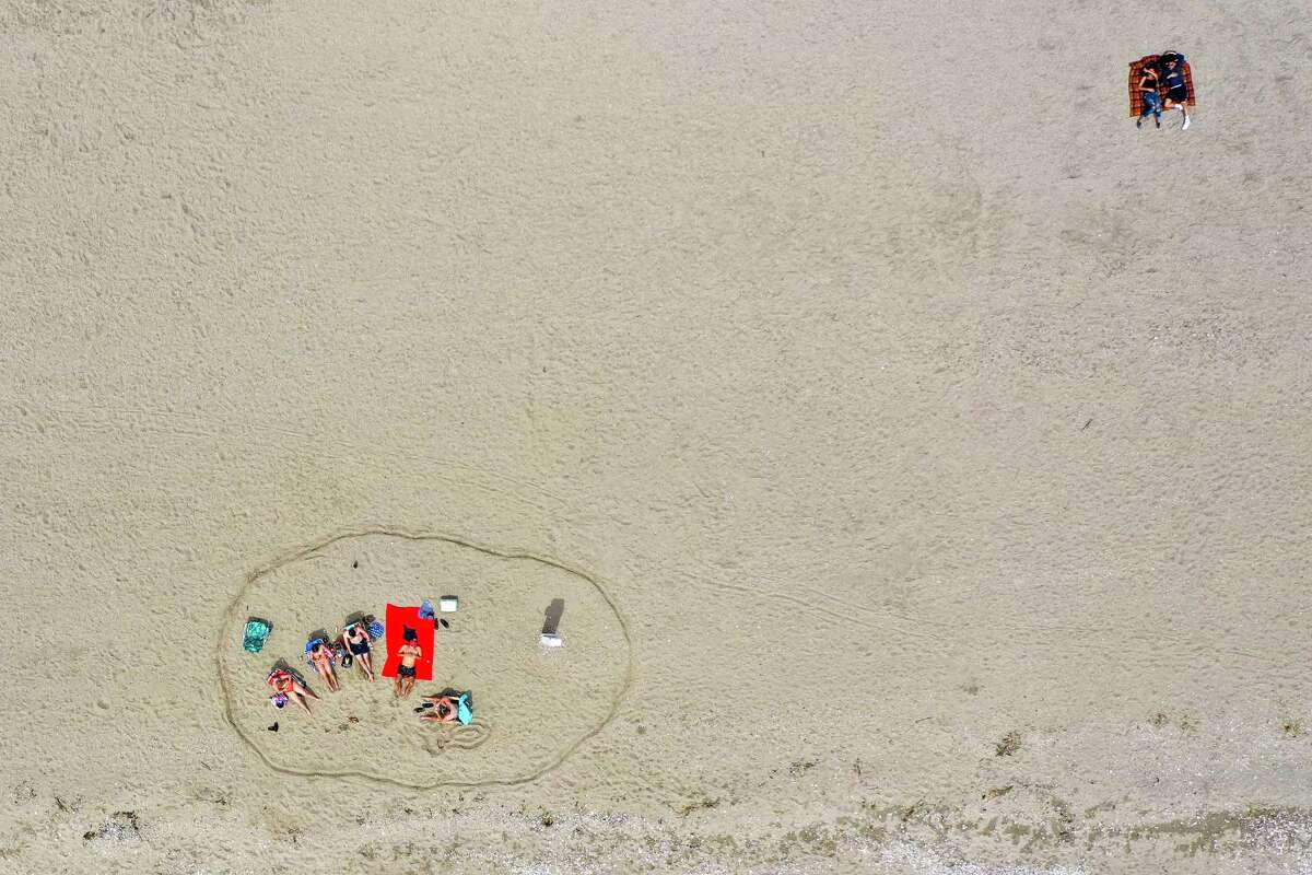 Draw a circle in the sand at one of the open beaches, and don't let anyone cross the threshold.