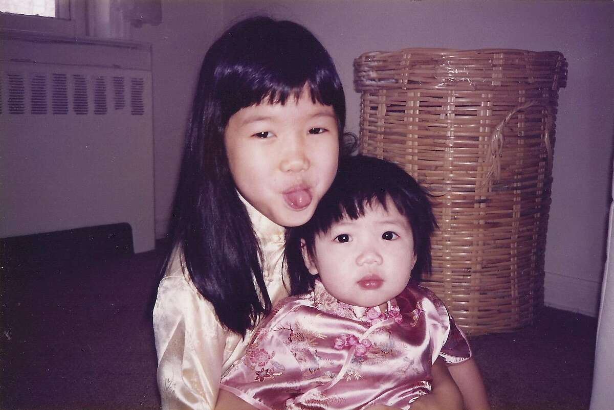 Soleil, left, and her younger sister as children.