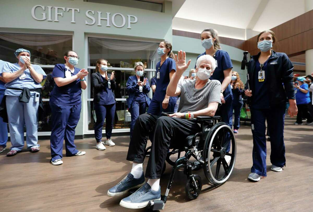 Phil Eaton waves to doctors, nurses and other hospital staff members as he is released from TIRR Memorial Hermann, after recovering from the coronavirus Tuesday, May 5, 2020, in The Woodlands. The 63-years-old principal at Lake Creek High School, was released from the hospital after a 51-day lengthy battle with COVID-19, including 21 days on a ventilator.