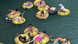 Tubers disregard social distancing May 5 on the Guadalupe River near New Braunfels.