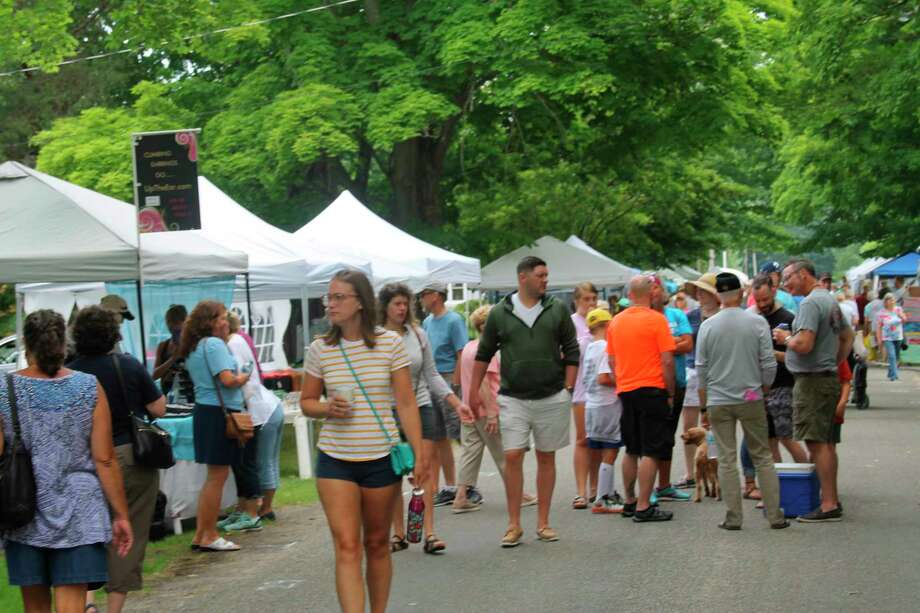 Crowds gather at an arts and crafts fair held during Arcadia Daze in 2019. This year's event has been canceled amid statewide restrictions prohibiting large gatherings. (File photo)
