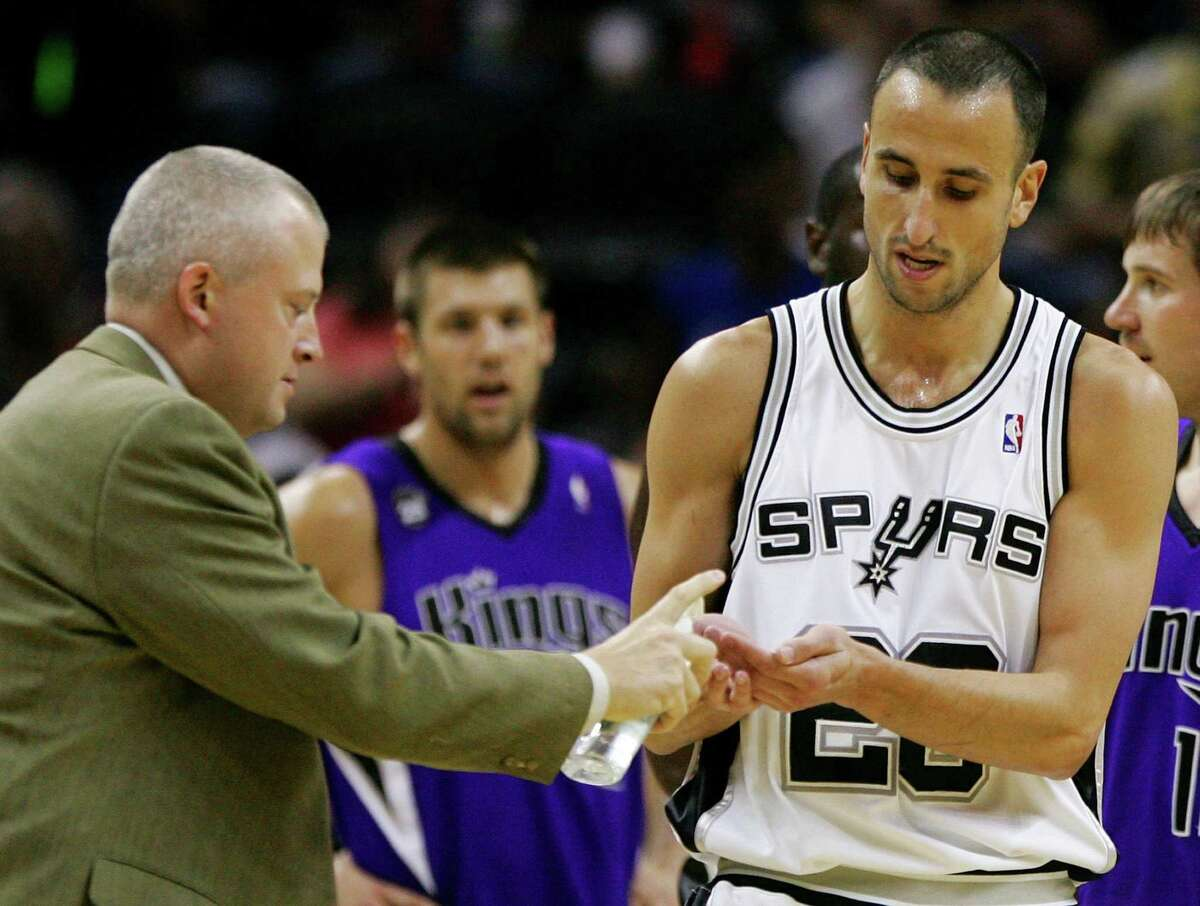 A team official applies hand sanitizer for San Antonio Spurs player Manu Ginobili's hands after the Spurs guard swatted a rogue bat from the air and removed it from the court during the first half of an NBA basketball game against the Sacramento Kings in 2009.